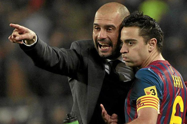 Xavi Hernández considera que el técnico Pep Guardiola es uno de los mejores. (Foto Prensa Libre: Hemeroteca PL)