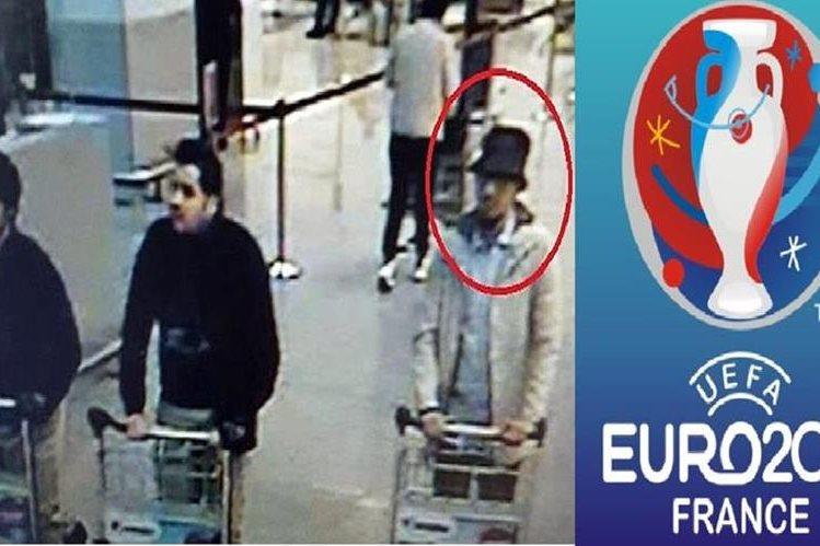 Mohamed Abrini, (d) es el tercer terrorista grabado en el aeropuerto de Bruselas.(AFP)