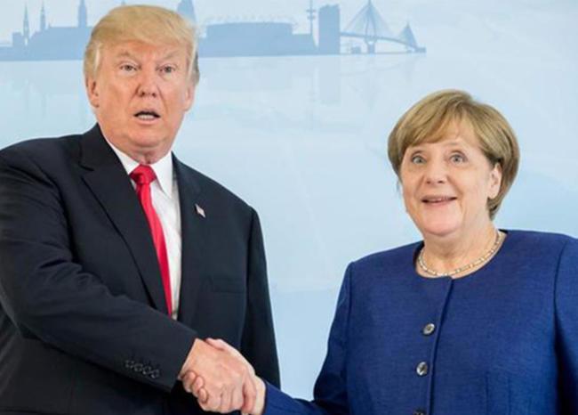 Donald Trump y Angela Merkel en Cumbre G20. Foto Prensa Libre: AFP.