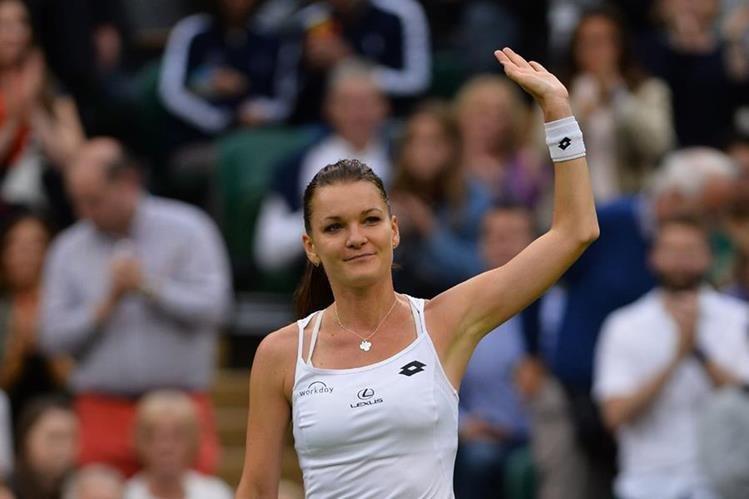 Radwanska dio su primer paso en Wimbledon al derrotar a una ucraniana. (Foto Prensa Libre: AFP)