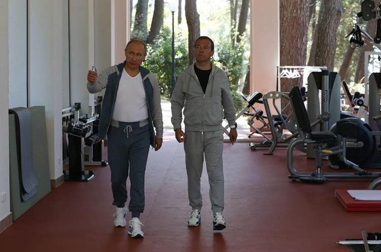 Russia's President Vladimir Putin (L) and Russian Prime Minister Dmitry Medvedev walk in a gym at the Bocharov Ruchei state residence in Sochi on August 30, 2015. AFP PHOTO / RIA NOVOSTI / YEKATERINA SHTUKINA