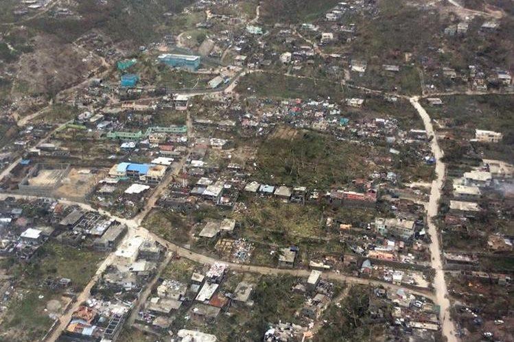 Vista aérea de Jeremie, localidad al este de Haití, una de las más golpeadas por el huracán Matthew. (Foto Prensa Libre: AFP).