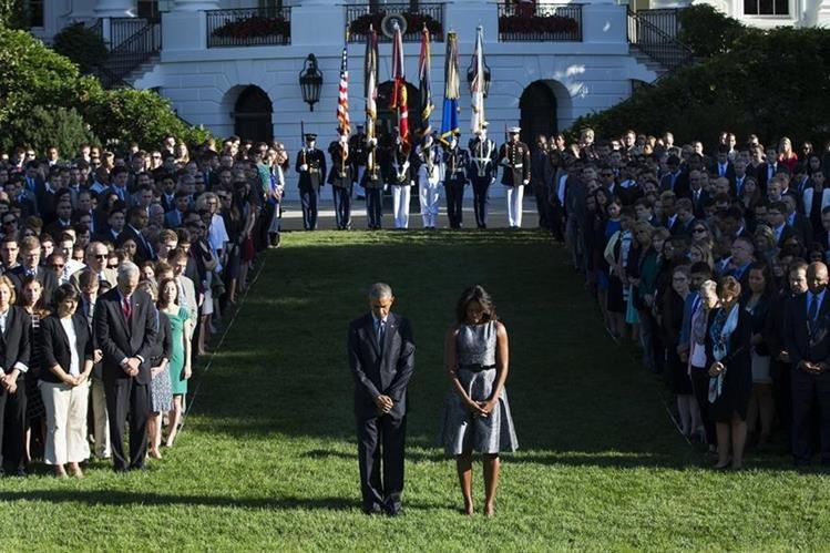 Barack Obama y su esposa Michelle, encabezan el acto en memoria de las víctimas de los atentados terroristas del 2001. (Foto Prensa Libre: AP).
