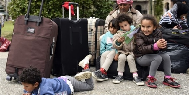 Primeros refugiados sirios llegan a Canadá. (Foto Prensa Libre: AP)