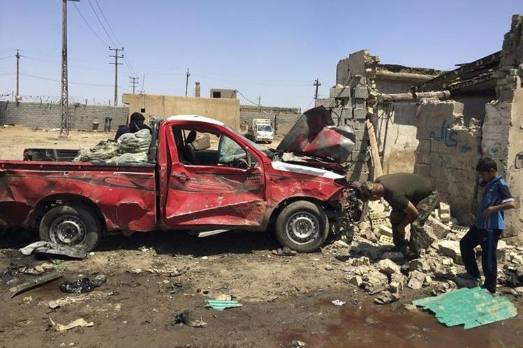 Imagen del carrobomba detonado en Bagdad. (Foto Prensa Libre: AP)