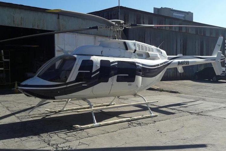 El helicóptero vinculado con Manuel Baldizón y hallado por el MP era rojo y entró a Guatemala procedente de Nicaragua. (Foto Prensa Libre: MP)