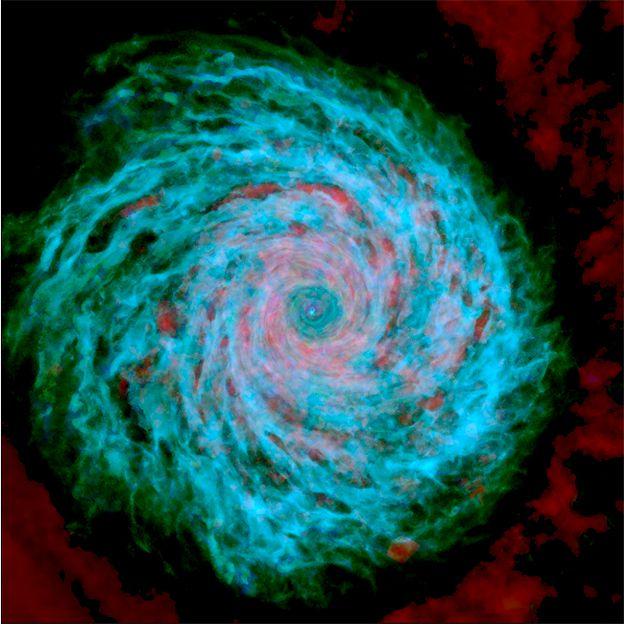 """""""Estas imágenes me gustan porque son hermosas"""", nos dijo Grand al mandarlas. """"Ésta muestra la estructura del disco de gas en detalle, y está coloreada de acuerdo a la temperatura del gas: azul es frío, verde es cálido y rojo es caliente"""". (HITS)."""