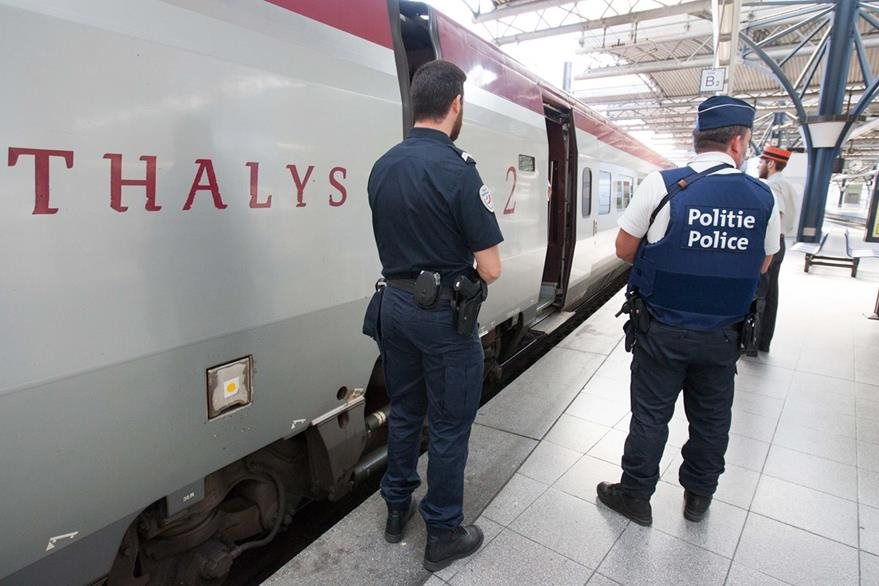 Member of belgian and french police stay next to a Thalys train at the Brussels Midi - Zuid train station, on Saturday, Aug. 22, 2015.  Security has become more visible after an attack on Friday of a Thalys train traveling from Amsterdam to Paris. (AP Photo/Francois Walschaerts)