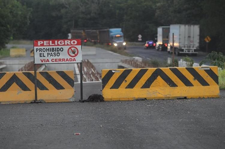 La reparación de un importante tramo carretero depende de Odebrecht, empresa que pese a tener denuncias penales tiene posibilidades de salir ventajosa. (Foto Prensa Libre: Hemeroteca PL)