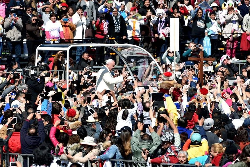 Pope Francis waves from the popemobile on his way to the Cathedral, in Mexico City on February 13, 2016. Francis became the first pope to enter Mexico