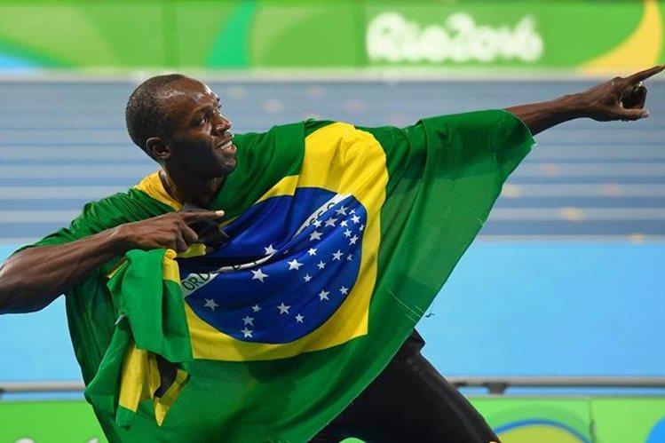 El velocista jamaicano aseguró que le gustaría jugar en el Mánchester United. (Foto Prensa Libre: AFP).
