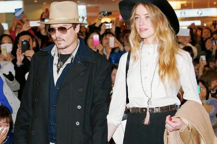 """El actor estadounidense Johnny Depp y su esposa, Amber Heard, llevaron a sus perros """"Boo"""" y """"Pistol"""" a Australia, para el rodaje de la secuela de """"Piratas del Caribe"""". (Foto Archivo AP)"""