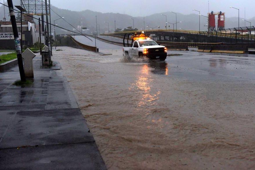 Asi lucen las calles de Manzanillo, Colima, tras llegada de Patricia. (Foto Prensa Libre: AFP).
