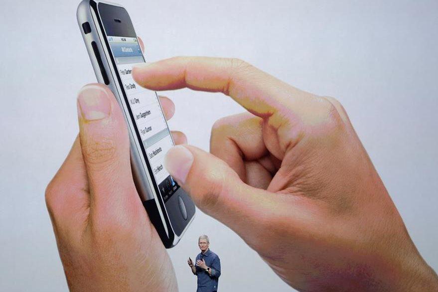 Tim Cook, durante la presentación de nuevos productos de Apple en septiembre del 2014. (Foto Prensa Libre: AP)