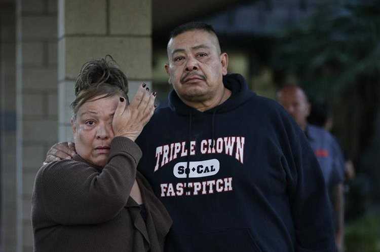 People wait at a community center for a family member who was near a shooting that killed multiple people at a social services center, Wednesday, Dec. 2, 2015, in San Bernardino, Calif. (AP Photo/Jae C. Hong)