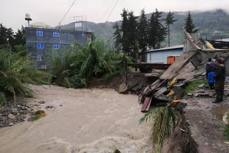 Desborde de río Cambalá provoca daños en casas de Barillas, Huehuetenango. (Foto Prensa Libre: Conred)