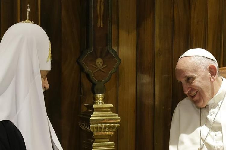Pope Francis, right, and Russian Orthodox Church Patriarch Kirill talk during their meeting at the Jose Marti International airport in Havana, Friday, Feb. 12, 2016. Pope Francis landed in Cuba Friday for the first-ever papal meeting with Patriarch Kirill, the head of the Russian Orthodox Church, a historic development in the 1,000-year schism within Christianity.(AP Photo/Gregorio Borgia)