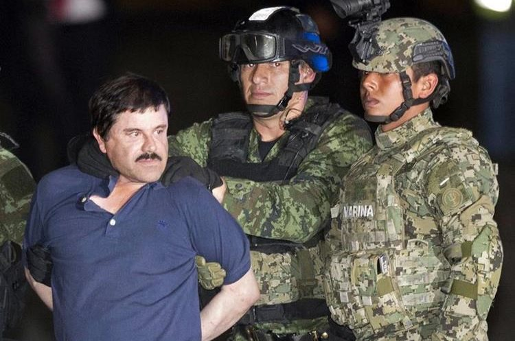 """In this Friday, Jan. 8, 2016 photo, Joaquin """"El Chapo"""" Guzman is made to face the press as he"""