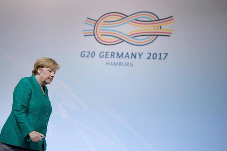La anfitriona del G20, Ángela Merkel, dijo estar satisfecha por los acuerdos sobre comercio. (Foto Prensa Libre: EFE)