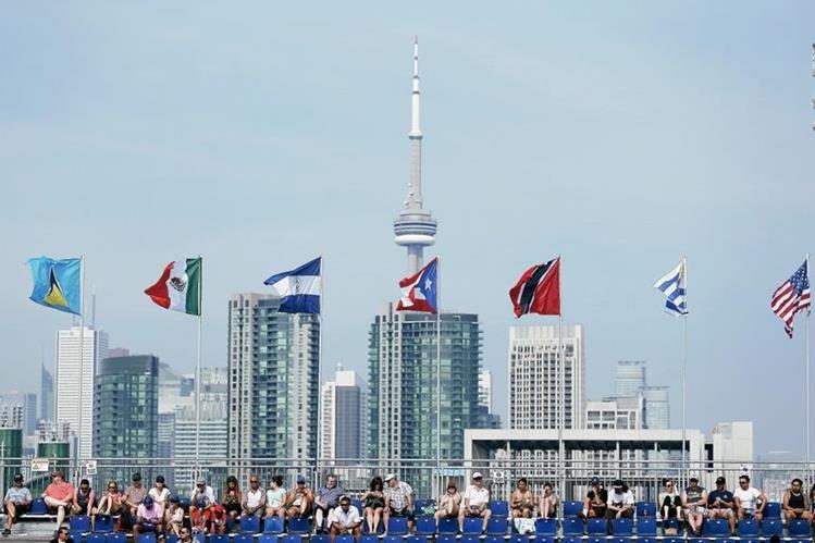 Los aficionados tan el toque de color a los Juegos Panamericanos. (Foto Prensa Libre: EFE)