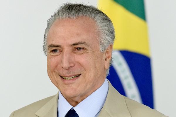 Michel Temer parciticpa en la presentación de los nuevos ministros en Brasilia.(AFP).