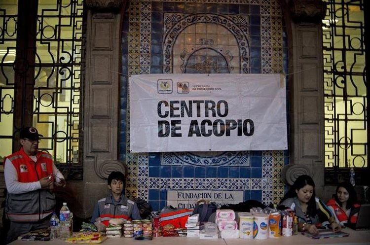 Civil Protection members remain in a provisional food storage center installed at the El Zocalo main square to collect food and supplies for victims of Patricia hurricane in Mexico City, on October 23, 2015. Monster Hurricane Patricia roared toward Mexico