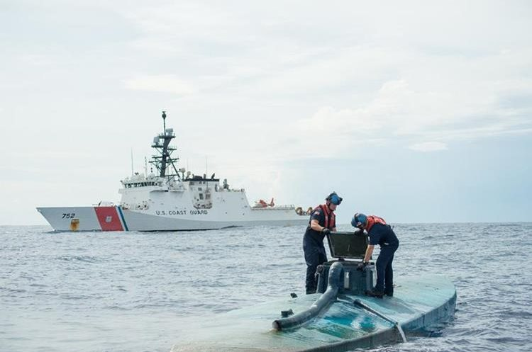 """In this image obtained from the US Coast Guard on August 6, 2015, a Coast Guard Cutter Stratton boarding team opens the bridge of a self-propelled semi-submersible intercepted in international waters off the coast of Central America, July 19, 2015. The US Coast Guard said it seized $181 million worth of cocaine from a submarine-like vessel in the eastern Pacific Ocean, but even more drugs sank during the bust. The Coast Guard seized 12,000 pounds (5,400 kilograms) of cocaine from four smugglers on a semi-submersible ship, the agency said August 6. The vessel, which was first spotted about 200 miles (320 kilometers) south of Mexico, was carrying a total of 16,000 pounds of narcotics, but as the ship was being towed, it took on water and sank. Some 4,000 pounds of narcotics were lost in the process.   == RESTRICTED TO EDITORIAL USE / MANDATORY CREDIT: """"AFP PHOTO HANDOUT-US COAST GUARD/Petty Officer 2nd Class LaNola Stone""""/ NO MARKETING - NO ADVERTISING CAMPAIGNS – NO A LA CARTE SALES / DISTRIBUTED AS A SERVICE TO CLIENTS =="""
