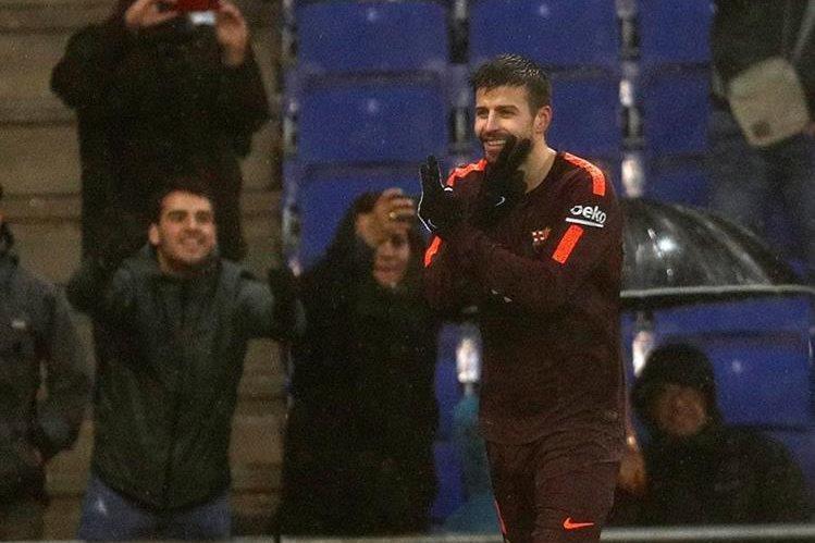 Gerard Piqué festejó en el último partido contra el Espanyol. (Foto Prensa Libre: EFE)