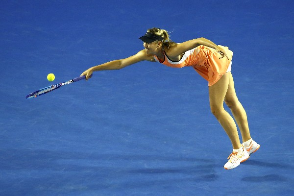 Sharapova logró su victoria 600 en los Torneo de la gira al vencer a la estadounidense Lauren Davis. (Foto Prensa Libre: AFP)