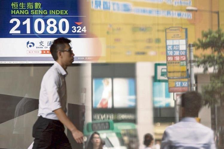 La caída de las bolsas de valores internacionales es efecto del menor crecimiento de la economía china, según analistas.