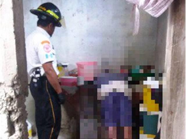 Mujer fue encontrada muerta dentro de la pila de su residencia en la zona 18. (Foto Prensa Libre: CBV)