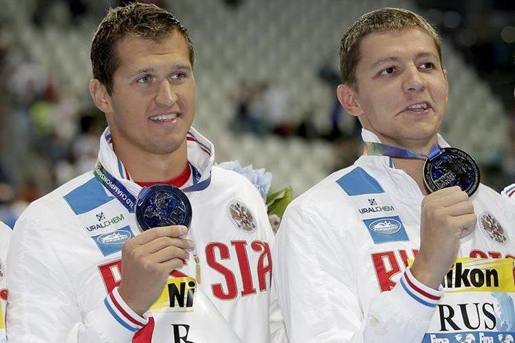 Nikita Lobintsev y Vladimir Morozov son dos de los nadadores rusos excluidos de Río 2016. (Foto Prensa Libre: AP)