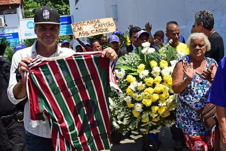 A man shows a shirt of Brazilian team Fluminense with the name of former capitan of Brazil