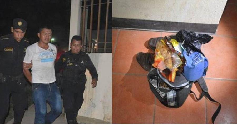 Agentes custodian a Édgar Alexánder Tzi, sindicado de haber robado en una ventad de alimentos en Ixcán. (Foto Prensa Libre: Eduardo Sam).