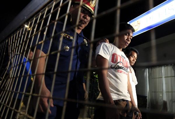 Varios delincuentes son detenisdoa en Manila, Filipinas. (EFE).