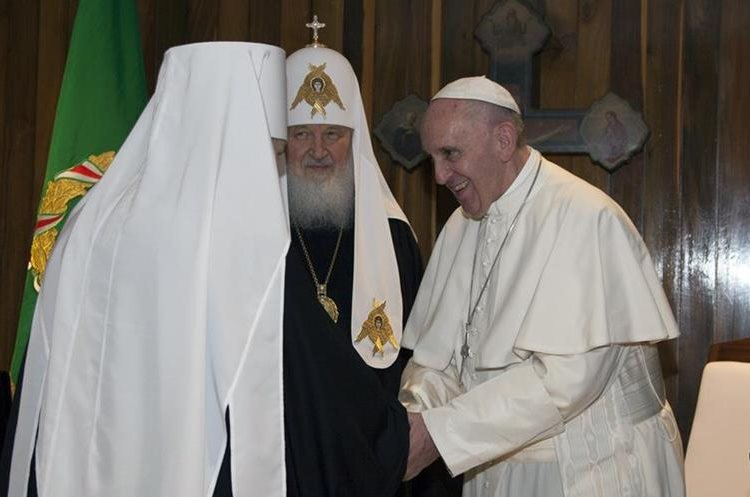 Russian Orthodox Church Patriarch Kirill, center, introduces a member of his delegation during their meeting at the Jose Marti airport in Havana, Cuba, Friday, Feb. 12, 2016. This is the first-ever papal meeting with the head of the Russian Orthodox Church, a historic development in the 1,000-year schism within Christianity. (Ismael Francisco/Cubadebate via AP)