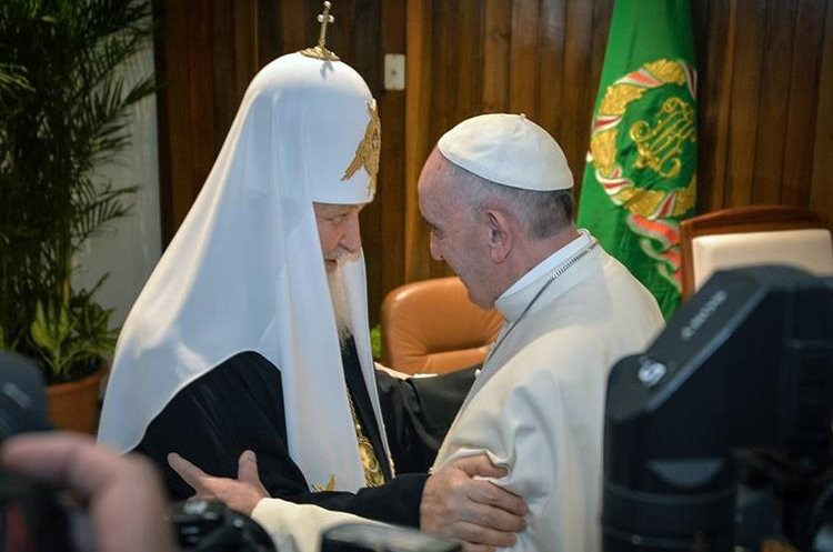 The head of the Russian Orthodox Church Patriarch  Kirill, left, and Pope Francis greet each other as as they meet at the Jose Marti airport in Havana, Cuba, Friday, Feb. 12, 2016. This is the first-ever papal meeting with the head of the Russian Orthodox Church, a historic development in the 1,000-year schism within Christianity. (Adalberto Roque/Pool photo via AP)