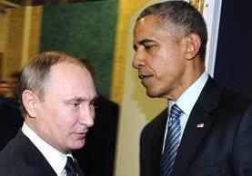 Vladimir Putin (i) se reúne con Barack Obama en la conferencia COP21 en Le Bourget,París.(AFP).