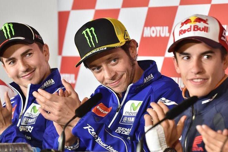Jorge Lorenzo, Valentino Rossi y Marc Márquez durante la conferencia de prensa previo al inicio del GP de Japón. (Foto Prensa Libre: AFP)