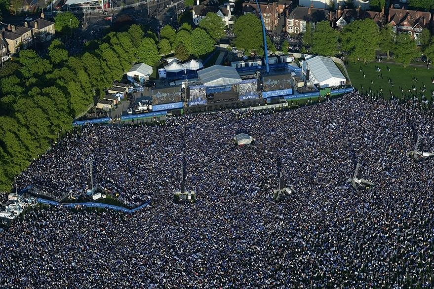 Leicester City fans gather to celebrate their team winning the English Premier League, in Victoria Park, Leicester, England, after the open top bus parade through the city centre, Monday May 16, 2016. (Tim Goode/PA via AP) UNITED KINGDOM OUT NO SALES NO ARCHIVE