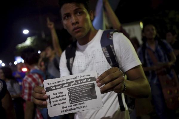 Un estudiante nicaragüense muestra su inconformidad para estas elecciones. (AFP).