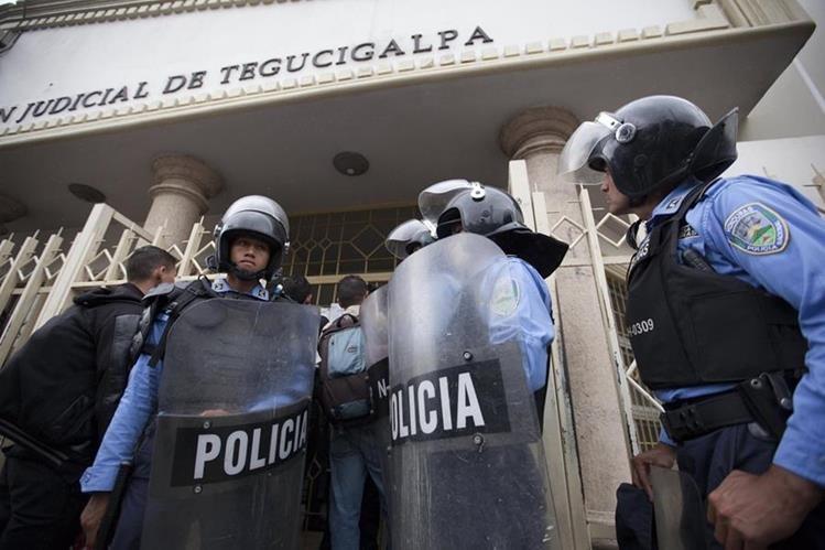 La violencia en Honduras deja un promedio de 13 homicidios a diario. (Foto Prensa Libre: EFE).