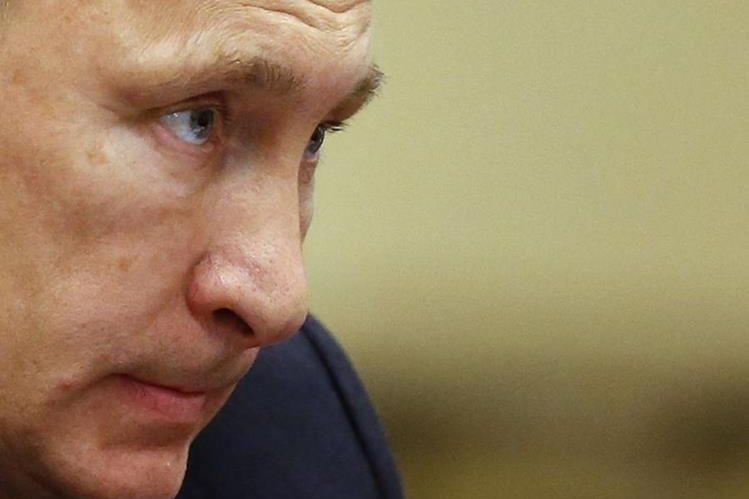 Vladimir Putin, encabeza por tercer año consecutivo la lista de personalidades más poderosas de la revista Forbes.(Foto Prensa Libre: AFP).