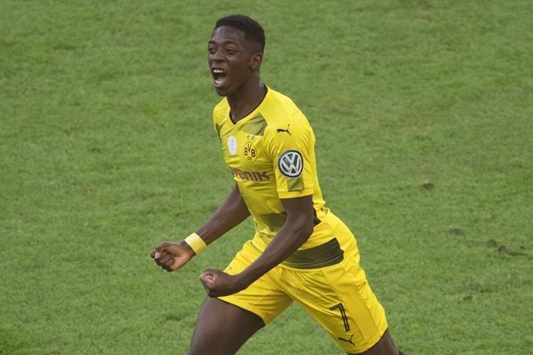 El jugador francés de 20 años será presentado el lunes por el Barcelona, según lo anunciaron en un comunicado de prensa. (Foto Prensa Libre: AFP)