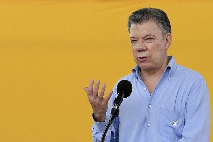 Juan Manuel Santos, presidente de Colombia, plantea una cumbre para discutir sobre el problema del narcotráfico con Centroamérica. (Foto Prensa Libre: EFE)