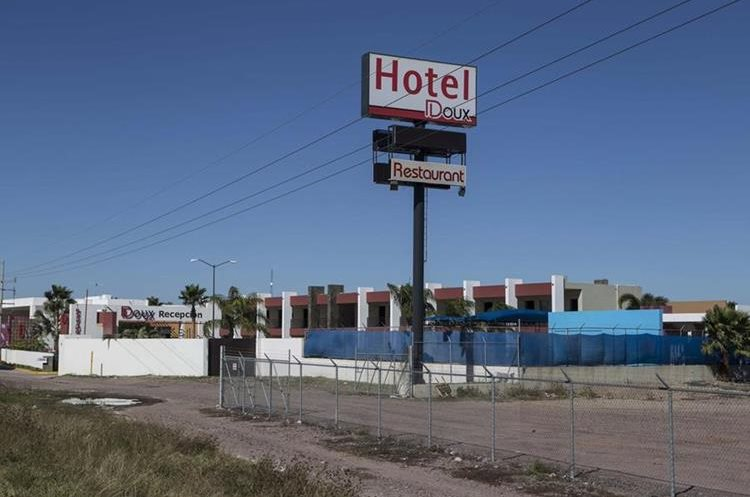 """This photo shows a view of the roadside hotel Doux in Los Mochis, Saturday, Jan. 9, 2016, where drug lord Joaquin """"El Chapo"""" Guzman was taken by Mexican marines after his recapture Friday. Guzman was then flown in a navy helicopter to Mexico City and taken back to Antiplano, the same maximum-security prison he escaped in July. (AP Photo/Christian Palma)"""