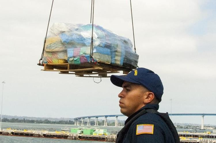 """Coast Guard Cutter Stratton crew offloads 34 metric tons of cocaine in San Diego, California on August 10, 2015.  A single US Coast Guard ship has recovered cocaine worth more than one billion dollars in under a year, authorities said Monday. The Stratton confiscated an impressive 29.9 tonnes of the drug in 10 months, from October 2012 through September 30, 2014, off Latin American coasts in the eastern Pacific, the coast guard reported. The cocaine -- from 23 interdiction operations -- is equal to about 33 million lines of cocaine or 336 million hits of crack, DEA estimates say.          AFP PHOTO / HANDOUT / US COAST GUARD PO3 ANDREA ANDERSON / RELEASED         == RESTRICTED TO EDITORIAL USE / MANDATORY CREDIT: """"AFP PHOTO / HANDOUT / US COAST GUARD / PO3 ANDREA ANDERSON """"/ NO MARKETING / NO ADVERTISING CAMPAIGNS / DISTRIBUTED AS A SERVICE TO CLIENTS =="""