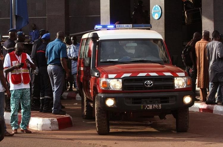 An ambulance seen outside the Radisson Blu hotel, after an attack by gunmen on the hotel, in Bamako, Mali, Friday, Nov. 20, 2015. Islamic extremists armed with guns and grenades stormed the luxury Radisson Blu hotel in Mali