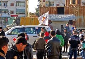 Comienza la operación de evacuación de los combatientes rebeldes y sus familias en Alepo. (Foto Prensa Libre:AFP).