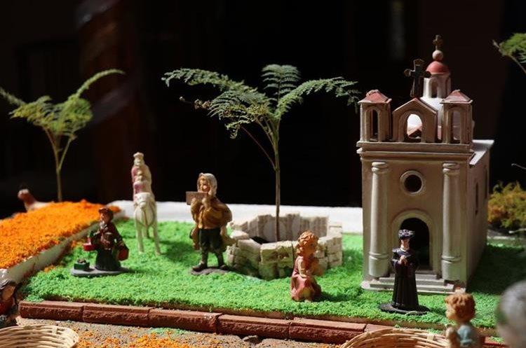 Las iglesias católicas elaboradas en miniatura son parte del tradicional nacimiento. (Foto Prensa Libre: Mike Castillo)